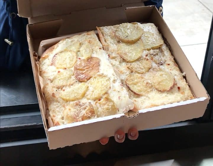 Chiosco's pizza window with potato and alfredo slice