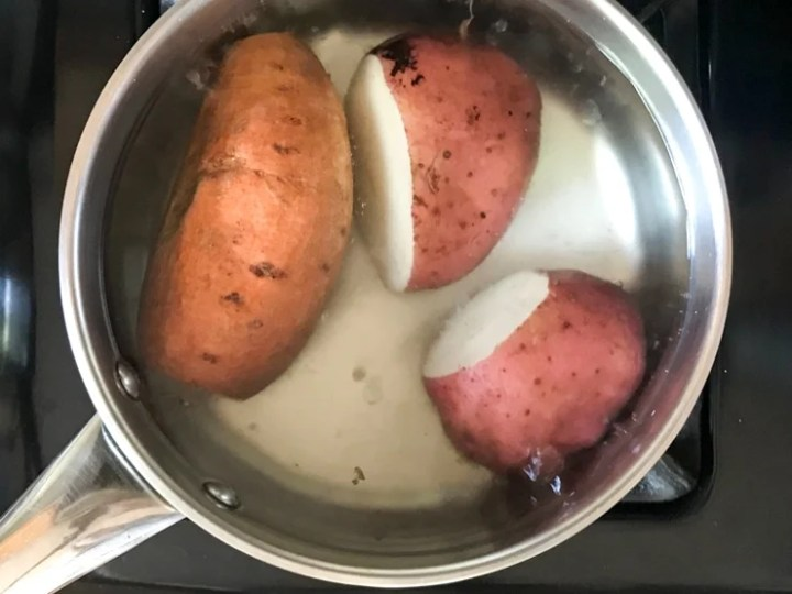 boiling potatoes in salt water on the stove
