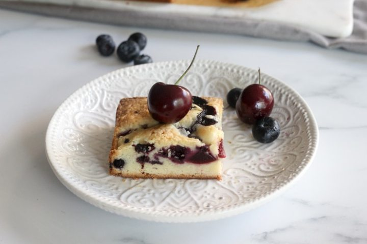 closeup with fresh blueberry and cherry cake bars with a cherry on top