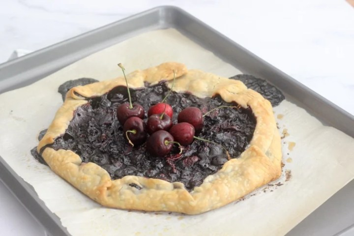 finished mixed berry galette on a baking sheet
