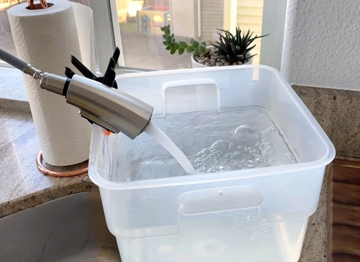 filling sous vide cambro container with water to cook brisket for 48 hours