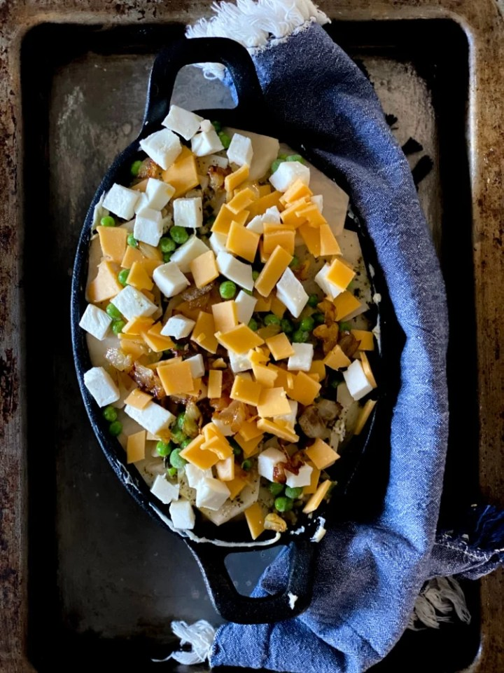 potatoes gratin in a cast iron casserole dish