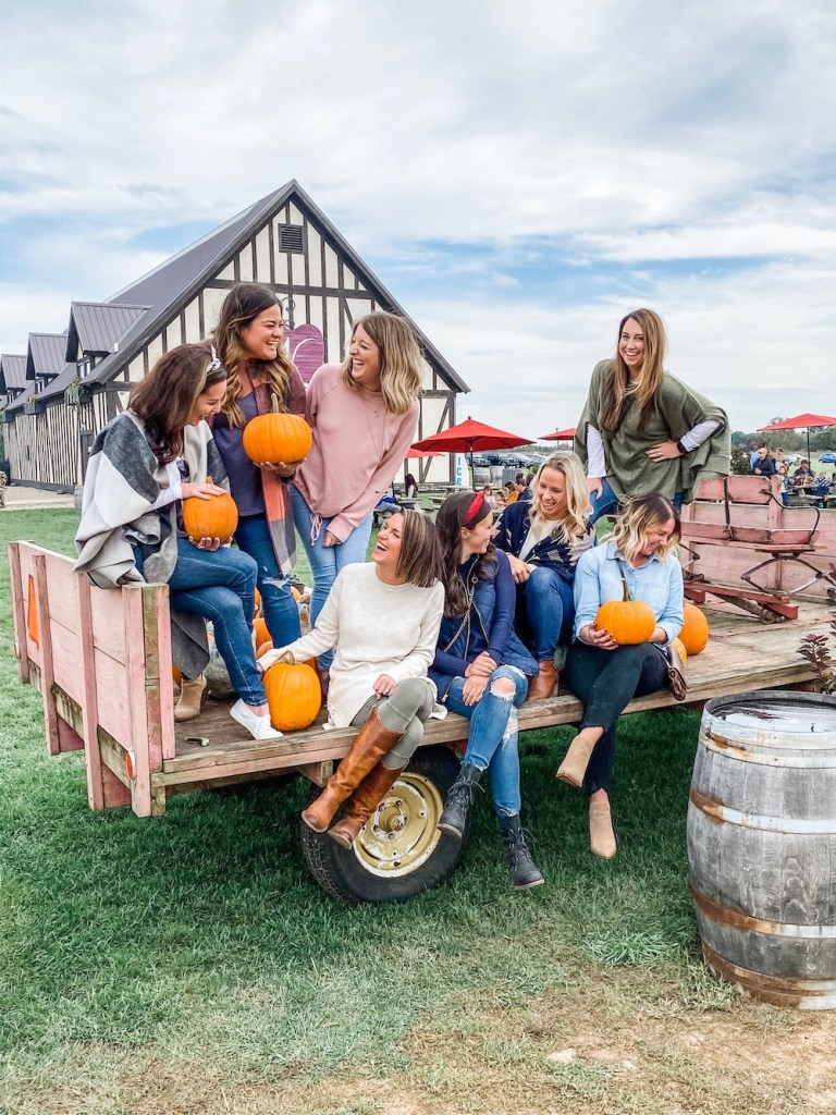 Group of Girls on a Wagon Holding Pumpkins