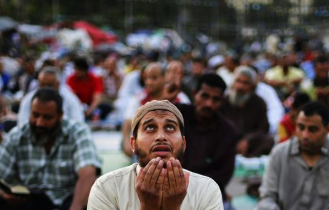 A supporter of the deposed Egyptian President Mohamed Mursi prays before he eats his Iftar meal on the first day of Ramadan, during a sit-in in Cairo July 10, 2013. The White House said on Wednesday it will take time to determine whether the Egyptian military's removal of Mursi constituted a coup, and called on the military to exercise restraint. REUTERS/Suhaib Salem (EGYPT - Tags: POLITICS CIVIL UNREST RELIGION) - RTX11J2J