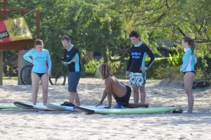 group-surf-lesson-on-beach