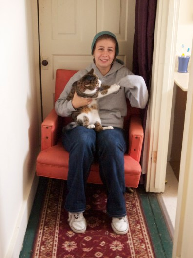 """i wanted one of those cute """"holding a cat in a chair"""" pictures but instead i got this. can't complain...it actually captured her personality perfectly.."""