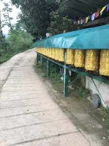 Prayer Wheels along the kora, the circumambulation around the Dalai Lama Temple.