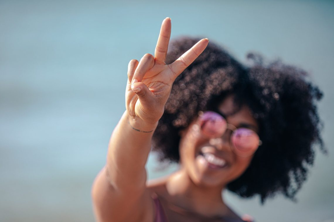 lady giving peace sign