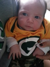 Week old Saige. Rockin' Packer Gear.