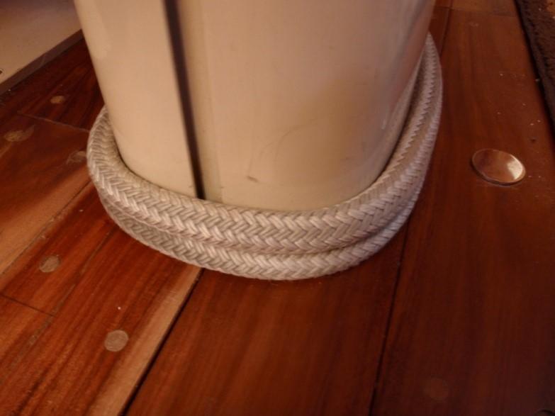 Rope/line around the bottom of the mast