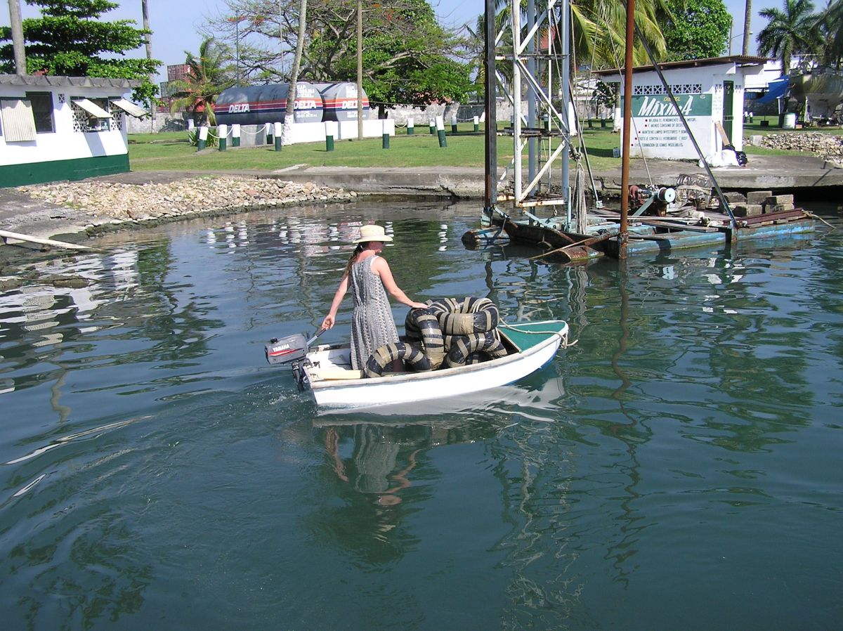 Jackie in the tiny dinghy with all the tyres to use as fenders