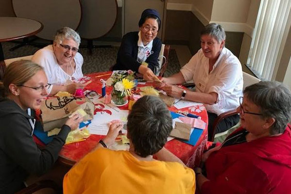 Charity-Moving-Forward-2017-gathering_tableconversations2