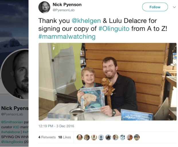 A tweet with a picture of a man and a child holding a children's book.