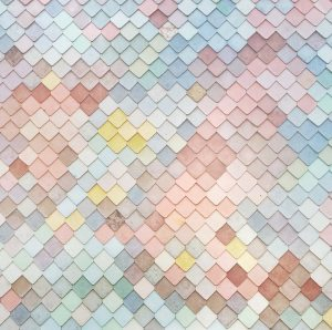 A pattern of pastel-colored tiles