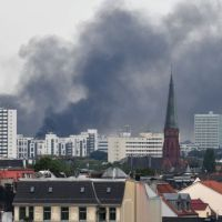 Smoke and Ash Fills Sky as Hamburg Falls Under Seige by Radical Leftist Extremists.