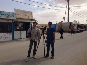 Dan Levitt '16 and Clay Haskell, assistant professor, work on a documentary film project at the Jordan-Syria border.