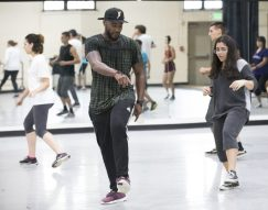 Prentiss Dantzler II, assistant professor of sociology, instructs Bridge Scholar students, with the help of some professional dancers, in the art of house dance during his class Heart of the City. Dantzler helps Martina Alvarez '21 get her steps correct. Photo by Jennifer Coombes