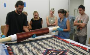 Students examine artifacts as part of internship.