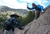 John McCormick and Edward Crawford strategically strike a curious outcrop.