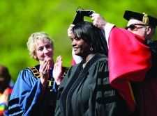 Jerri Marr, the former forest supervisor whose calm demeanor reassured residents during the Waldo Canyon Fire, receives an honorary degree at CC Commencement.