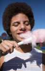 Jonathan Williams '19 eats some cotton candy at the Ahlberg Center Open House and Fun Fair during Family and Friends Weekend.