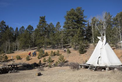 At the end of their Friday lesson where the classroom may be a teepee, a grove of aspens or a picnic bench next to a lake at the Catamount Center, Columbine Elementary School fifth-graders and CC students walk up the hill where buses are waiting to take students back to Woodland Park.
