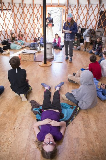 As CC student Robin Grathwohl '20 reads a story about a muskrat, the fifth-graders are allowed to rest and listen before a discussion. CC students are responsible for writing lessons, curriculum, and activities with intention as they try to meet the environmental education standards of the state and their own personal portfolio.