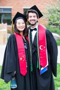 Zoraida Hu of China and Alpcan Karamanoglu of Turkey wear international student stoles representing their countries.