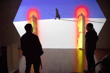 Ortiz checks in to see how his video installation is coming together at the Fine Arts Center where his new exhibit of work is showing through Jan. 6. Photo by Jennifer Coombes