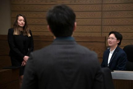The prosecution questions Lingquan Qi, freshman, during a mock trial practice on Tuesday, February 18, 2020 at the El Paso County Combined Courts. Colorado College hosts the regional mock trial tournament this weekend. (Photo by Katie Klann)