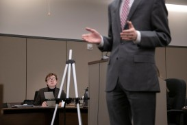Eric Ohlund, senior, watches as Daniel Lawrence, senior, speaks during a mock trial practice on Tuesday, February 18, 2020 at the El Paso County Combined Courts. Colorado College hosts the regional mock trial tournament this weekend. (Photo by Katie Klann)