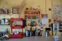 The colorful New Synergy House kitchen is kept organized and clean for group and individual meals and food storage.