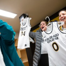 Talia Cloud, center, and Jordan Meltzer react to their new jerseys on Friday, February 7, 2020 at El Pomar Sports Center in Colorado Springs, Colorado. (Photo by Katie Klann)