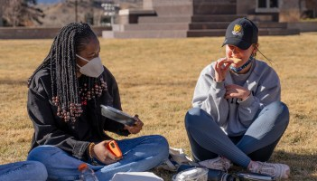 Olamide Olayiwoln '24 and Ester Cornish '24 enjoy an afternoon on Worner Quad on Jan. 20, with cookie decorating kits to celebrate Inauguration Day. Photo by Skye Schelz '21