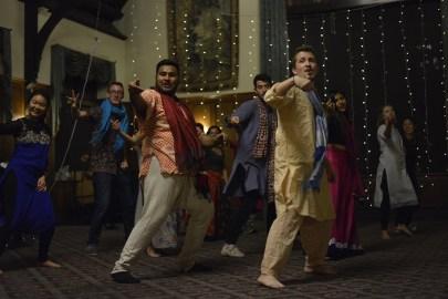Andrej Blazhevski and Aabhusan Khadka dance at the annual Diwali celebration. Nov. 10, 2017 (Photo by Rachel Delley '20).