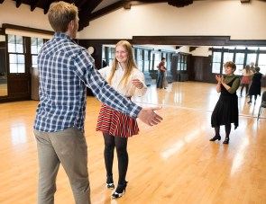 Marcia Dobson applauds Joel Frykholm and Haley Kolgate as they finish a dance during a ballroom dancing class. (Photo by Jennifer Coombes)