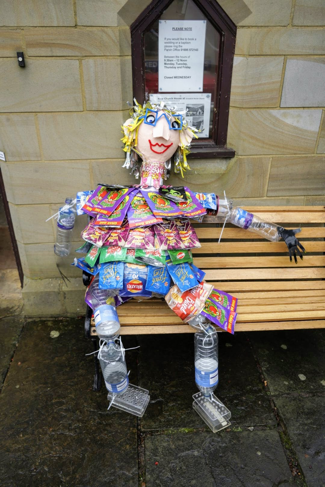 Lucy, recycled scarecrow sitting on a bench