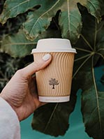 Hand holding a sustainable coffee cup