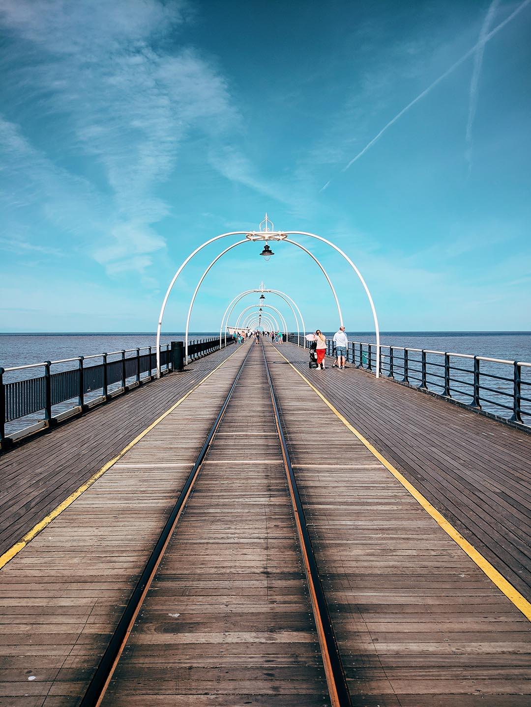 People walking along Southport Pier