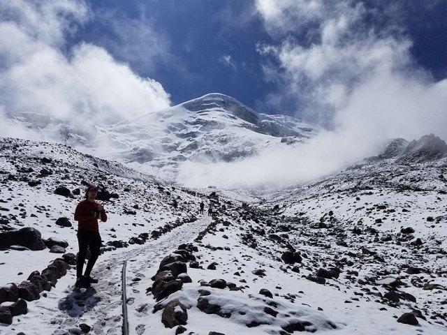 Students climb the snowy slopes of Chimbarazo in Ecuador.