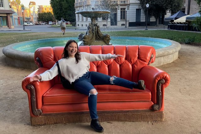 """Sky Blanton poses on a couch from """"Friends."""""""