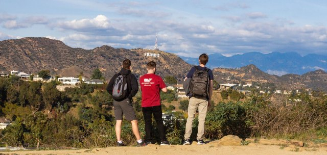 Three people looking at Mount Hollywood