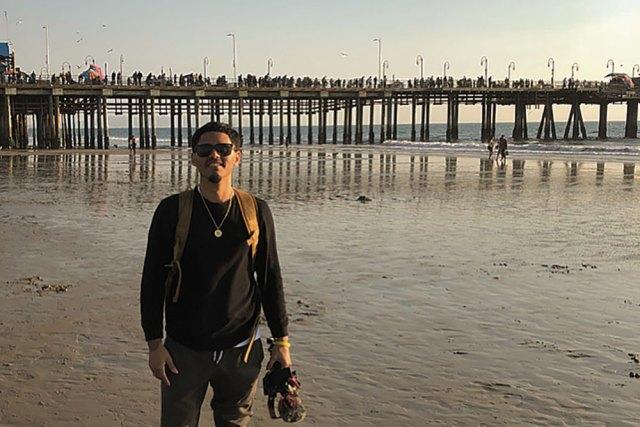 Victor Ramirez Cruz standing in front of a pier