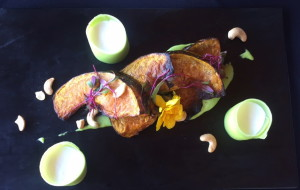 Roasted pumpkin with coconut foam, wasbi ribbon, pea and wasabi puree, and cashews