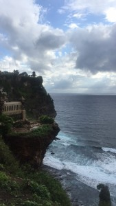View to the left of center, Uluwatu temple on the top edge of the cliff