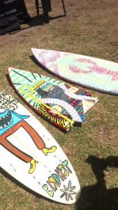 Handpainted surfboards selling along the beach