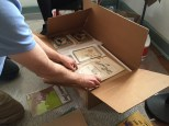 Siemon unpacking a box of his Daar Kom Die Alabama artifacts.