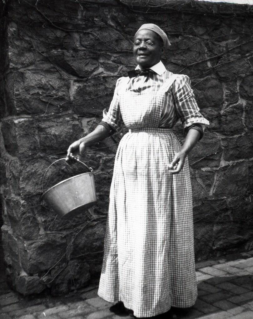 Lottie Rollins, the head cook in her uniform in 1904.