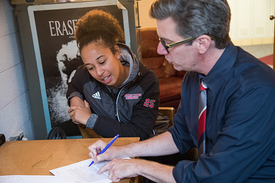 Photo of a student mentored by a professor at Detroit Mercy
