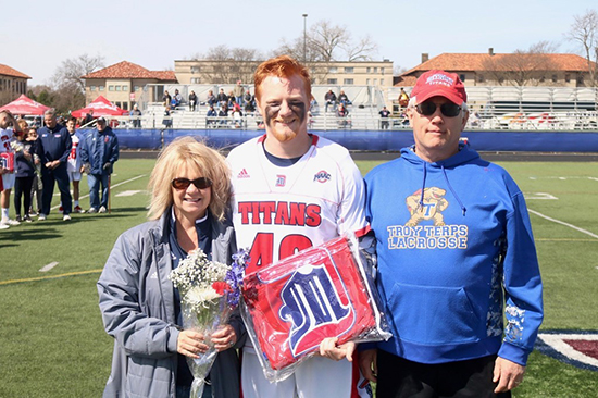 Nicholas Boynton poses for a photo with his parents.